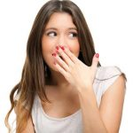 lady suffering from halitosis and bad breath